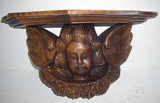 large-carved-wooden-cherubwall-corbel
