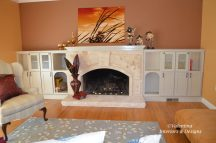 Travertine stone fireplace and wood mantel