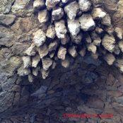 Under the stone pillars